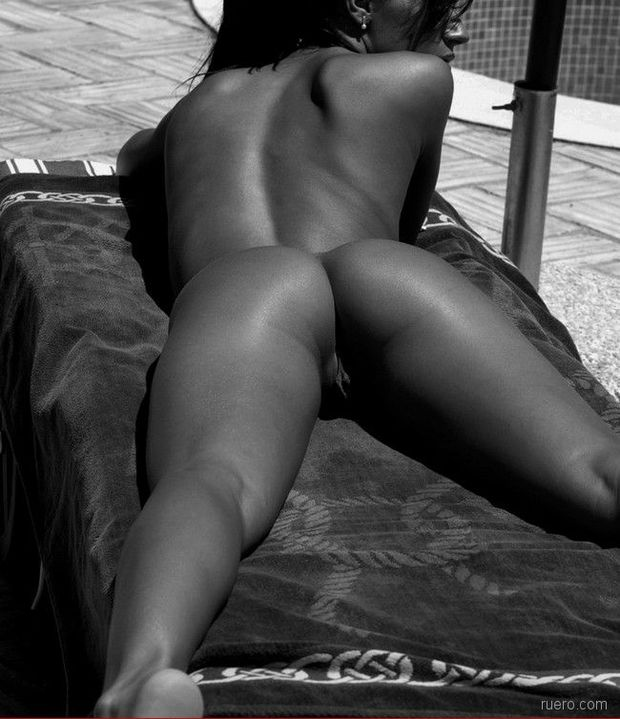Laying out naked.; Babe