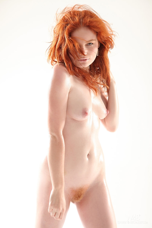 redhead in front of white surface; Red Head Stylish Unshaven Pussy